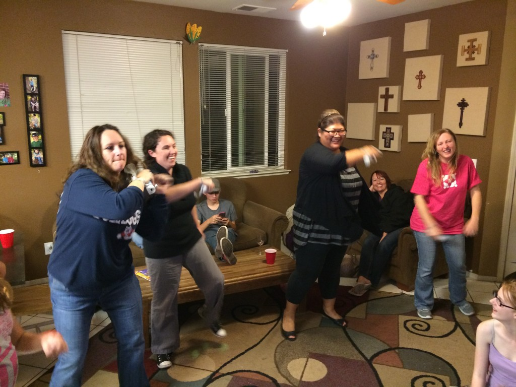 The ladies in a Wii dance-off. The guys just laughed...and took video for future reference...