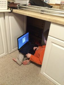 Sometimes...under the counter is the best place to play Minecraft.